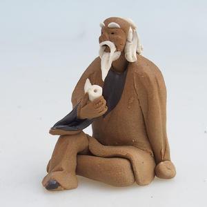 Keramická figurka - mudrc s dýmkou