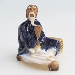 Keramická figurka - mudrc s flétnou
