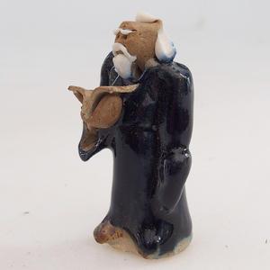 Keramická figurka - mudrc s knihou
