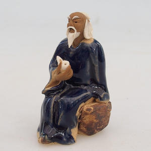 Keramická figurka - mudrc s fajfkou