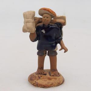 Keramická figurka - sběrač rýže