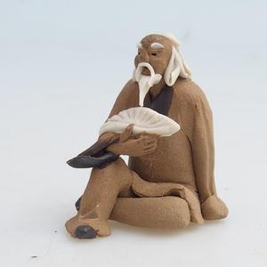 Keramická figurka - mudrc s vějířem